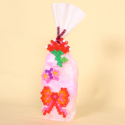 Schleife/Blume/Schmetterling
